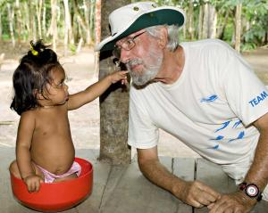 Jean-Michel Cousteau with child in the Amazon