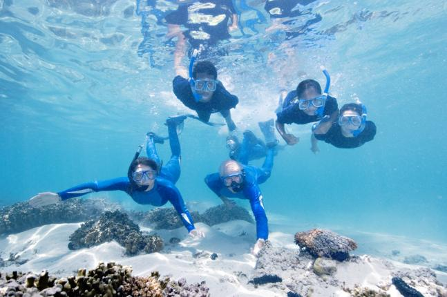 "Celine Cousteau and Dr. Richard Murphy share their knowledge and passion of the corals reefs with local students in America Samoa while on expedition for Ocean Futures Society's PBS special, ""America's Underwater Treasures."""