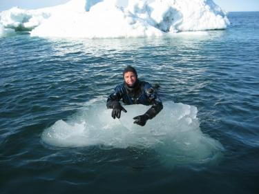 Ocean Futures diver in the Arctic ice