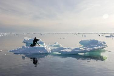 Director of Photography Matthew Ferraro films on the ice in the Canadian Arctic